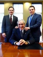 Willie McDonald, seated, his son, Bob, left, and grandson Robert McDonald all work at CedarStone Bank.