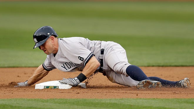 New York Yankees' Brett Gardner steals second base during the first inning of a baseball game against the Oakland Athletics Thursday, May 19, 2016, in Oakland, Calif.