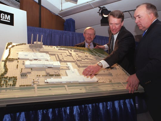 As mayor, David Hollister, left, helped bring two General Motors assembly plants to the Lansing region. He's pictured here with Rick Wagoner, then GM chairman and CEO, and Michigan Gov. John Engler. They were looking at plans for the Lansing Grand River Assembly Plant near downtown. The plant opened in 2001.