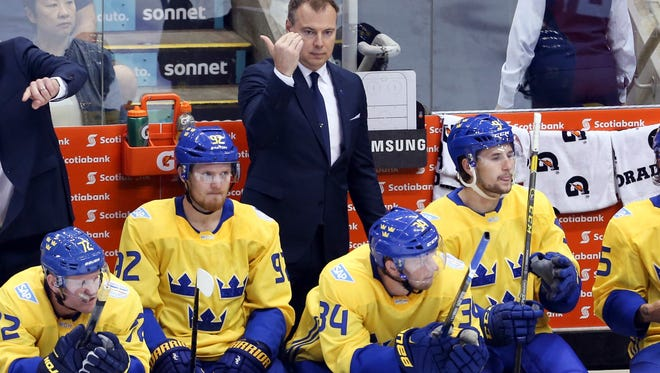 Sep 18, 2016; Toronto, Ontario, Canada; Team Sweden Head Coach Rikard Gronborg directs his players during the first period against Team Russia during preliminary round play in the 2016 World Cup of Hockey at Air Canada Centre. Sweden won 2-1. Mandatory Credit: Kevin Sousa-USA TODAY Sports