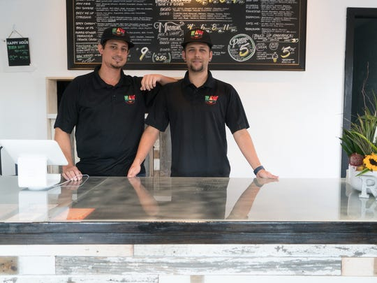 RAW Remedy wonders Josh Pena and Nick Valdez stand behind the counter of their new storefront in Palm Springs, August 30, 2016.