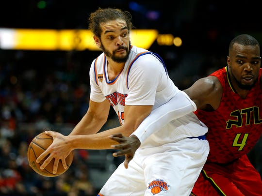 In this Jan. 29, 2017 file photo, New York Knicks center Joakim Noah (13) looks to pass as Atlanta Hawks forward Paul Millsap (4) is defending in the first overtime of an NBA basketball game in Atlanta.  Noah has been suspended 20 games without pay for violating the league's anti-drug policy.  The NBA announced the suspension Saturday, March 25 saying Noah tested positive for Selective Androgen Receptor Modulator LGD-4033 _ something found in some over-the-counter supplements.