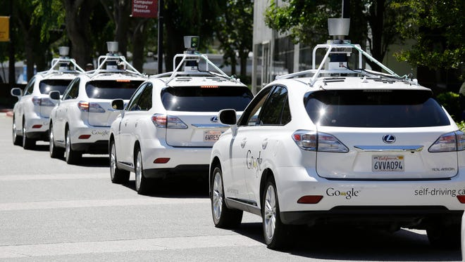 A row of Google self-driving cars outside the Computer History Museum in Mountain View, Calif.