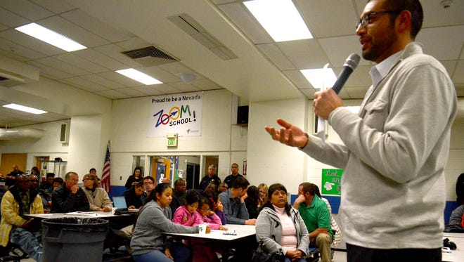 Reno  City Councilman Oscar Delgado speaks at a public meeting on Monday about neighborhood safety following three shootings in December. The meeting was held at Glenn Duncan Elementary School.