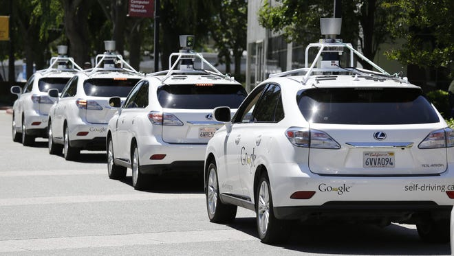 A row of Google self-driving cars outside the Computer History Museum in Mountain View, Calif. , in 2014