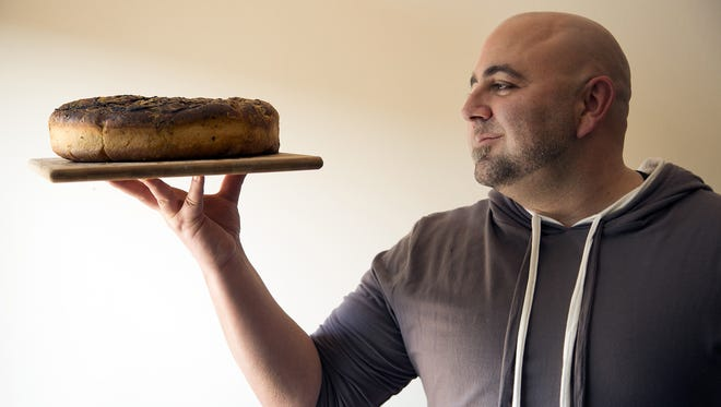 Duff Goldman holds his focaccia.