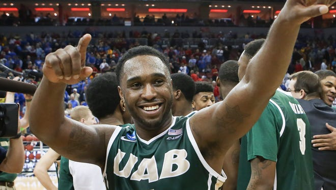UAB guard Denzell Watts acknowledges the fans as he and his team celebrate their win over Iowa State in an NCAA tournament second round college basketball game in Louisville, Ky., Thursday, March 19, 2015. UAB won the game 60-59. (AP Photo/David Stephenson)