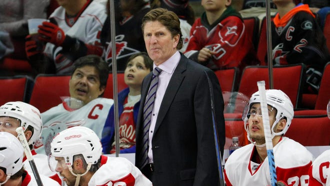 Detroit Red Wings coach Mike Babcock looks on against the Carolina Hurricanes at PNC Arena.