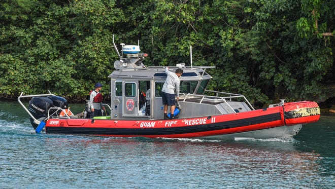 A Guam Fire Department rigid-hull vessel prepares to enter the boat basin in Hagåtña Monday afternoon after aiding in the search for a missing swimmer along the cliff line of Pagat, Mangilao.