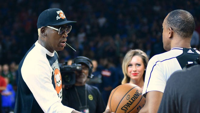 In this Apr 10, 2017 photo taking in Auburn Hills, MI., former Detroit Pistons player Dennis Rodman is recognized before a game against the Washington Wizards at The Palace of Auburn Hills.