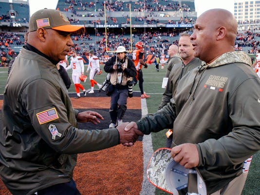 Cincinnati Bengals head coach Marvin Lewis, left, and Cleveland Browns head coach Hue Jackson meet on the field after an NFL football game, Sunday, Nov. 26, 2017, in Cincinnati. (AP Photo/Gary Landers)