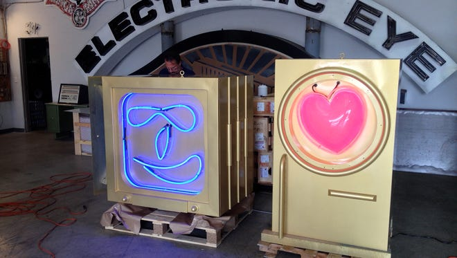 Metrobot's new neon face and heart.