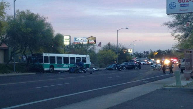 The scene following a collision between a Valley Metro bus and at least two other vehicles in north Phoenix Wednesday.