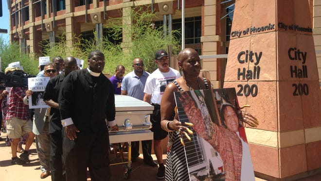 Supporters of Michelle Cusseaux march her casket through downtown Phoenix in protest of Phoenix police department's handling of her death.
