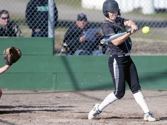 Amber Bumbalough of Klahowya connects on a home run on Wednesday against Seattle Christian. Bumbalough batted .671 last season for the Eagles.