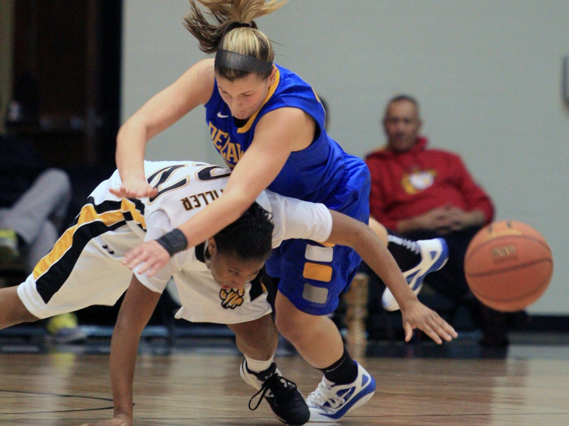 Delaware guard Lauren Carra is called for a foul as she tangles with Towson guard Tanisha McTiller in the first half.