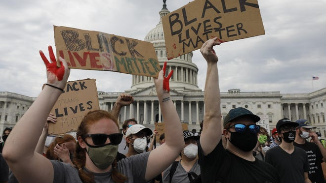 Demonstrators protest against the death in Minneapolis of George Floyd, on Capitol Hill in Washington on Wednesday.