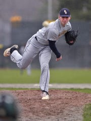 Schoolcraft's Mickey Clark delivers a pitch during