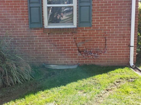 Police said alleged bank robber Scott Tilden damaged this apartment building when he crashed into it while fleeing police in a vehicle he stole in Cumberland County on Monday, Oct. 5, 2015.