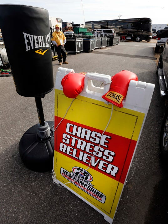 A punching bag is seen in the drivers area  at New Hampshire Motor Speedway Friday, Sept. 25, 2015, in Loudon, N.H. The bag was set up before this weeks Sprint Cup series auto race after last weeks scuffle between NASCAR drivers Kevin Harvick and Jimmie Johnson. (AP Photo/Jim Cole)
