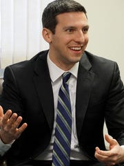 Senate candidate P.G. Sittenfeld speaks in a sit-down