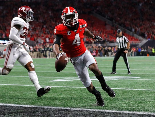 Georgia's Mecole Hardman scores a touchdown during
