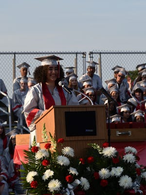 The Class of 2017 poet laureate Taina Ruiz presents her commencement poem during the June 14, 2017 Vineland High School graduation.