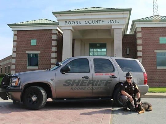 Deputy Jacob Pickett and his K-9 partner, Brik, outside