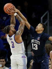 Penn State guard Rasir Bolton, right, blocks a shot by DePaul guard Devin Gage during the first half of an NCAA college basketball game Thursday, Nov. 15, 2018, in Chicago. (AP Photo/Nam Y. Huh)