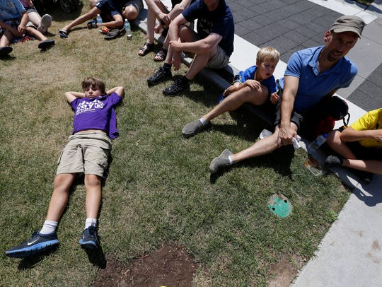 Owen Hall, 9, of Appleton relaxes while listening to
