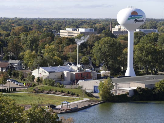 A water tower stands in a neighborhood near Menasha's downtown.