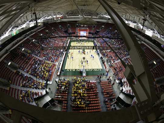 A view from the Resch Center rafters of the 2015 WIAA state girls basketball tournament in Ashwaubenon. A WIAA proposal up for vote Jan. 31 would move 25 small private schools and five small public schools up one division in boys and girls basketball.