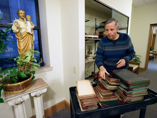 Ed Brodnicki sorts through old historical registers