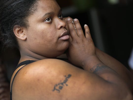 Maida Jackson-Felton of Green Bay listens Tuesday as