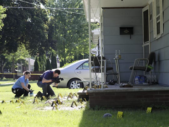 Investigators with the Appleton Police Department examine the crime scene on Foster Court last weekend following the shooting death of  Jose Gil-Leon.
