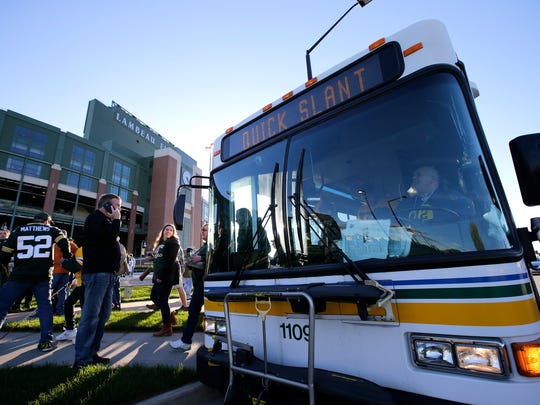 A Green Bay Metro Transit bus drops off fans along