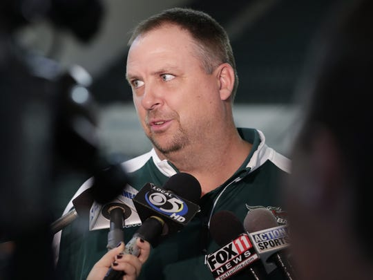 University of Wisconsin-Green Bay men's basketball head coach Linc Darner answers questions from the the media at UWGB basketball media day at the Kress Center on Monday.