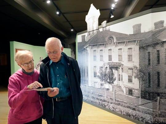 Barb and Paul Ramberg, of Baldwin, take a tour of the Outagamie County Asylum for the Chronic Insane exhibit in November 2016 at the History Museum at the Castle.