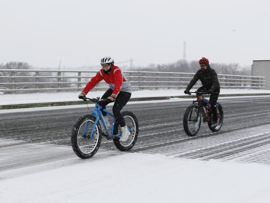 Bicyclists take a winter ride during Manitowoc's first