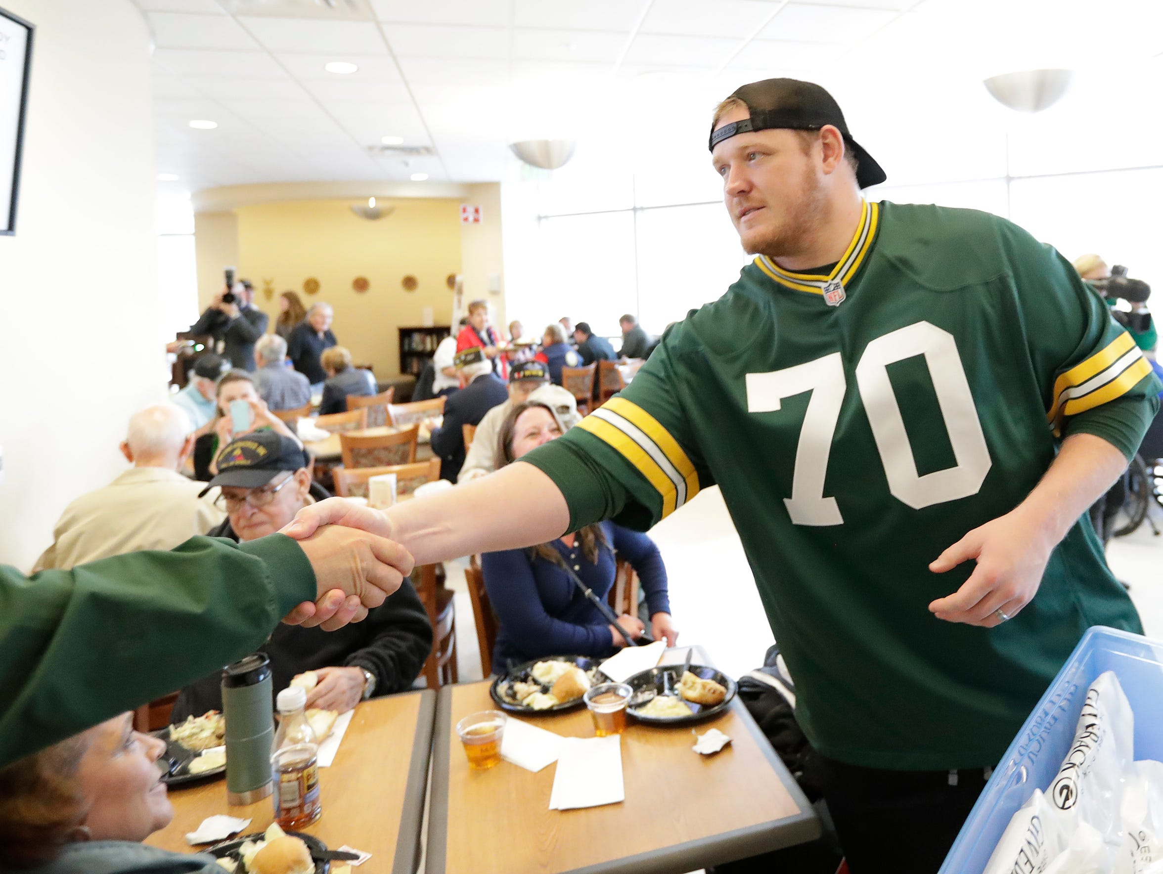 Green Bay Packers guard T.J. Lang (70) shakes the hand