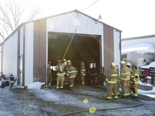 Kellnersville firefighters work to put out a fire started