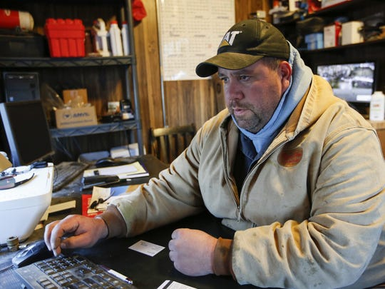 Brian Micke takes care of the business aspect of the dairy farm from his office Tuesday, Jan. 4, in Reedsville.