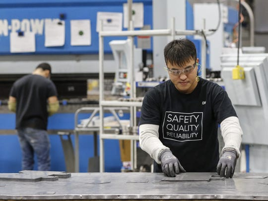 Orion Energy Systems announced it will be adding 30 new full-time jobs in Manitowoc. Pictured here, an assembly worker works in the Manitowoc plant Jan. 9.