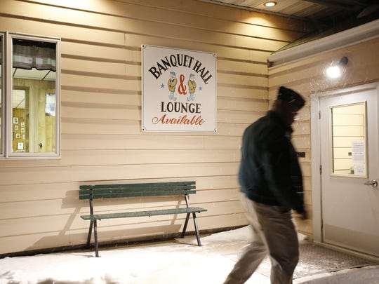 Mike Wojta leaves the Vets Club building for the night in Two Rivers Monday, Jan. 9.