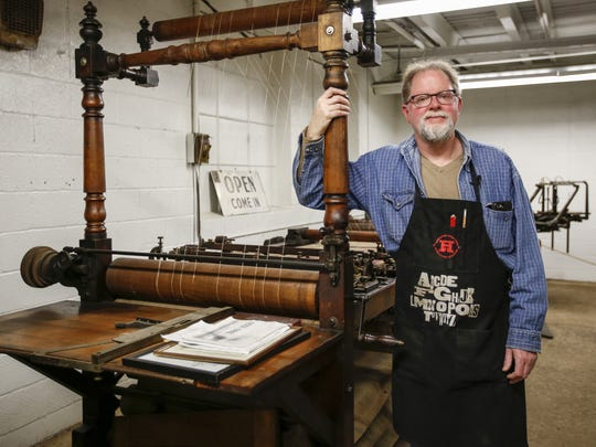 Museum Director Jim Moran stands next to his grandfather's Hickok double beam ruling machine Wednesday, Jan. 18, in Two Rivers. Moran is a third-generation letterpress printer.