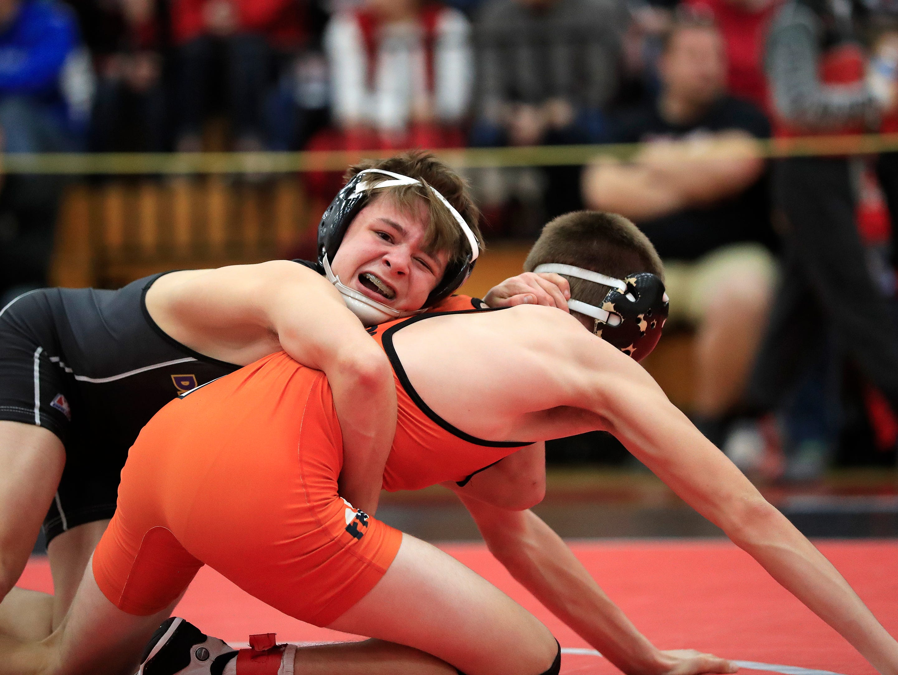 Denmark's Brock Bergelin wrestles Oconto Falls' Bryce Peterson in the 120-pound championship bout on Saturday at the Pulaski Invitational wrestling tournament. Bergelin won the match with a 13-2 decision to earn his 150th win of his high school career.