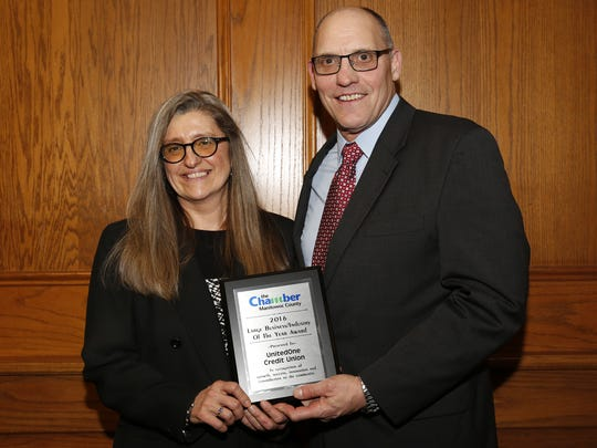 United One Credit Union CEO Kim Rooney (left) accepted the Chamber's award for Large Business of the Year presented by Lakeshore Technical College's Mike Lanser Wednesday, Feb. 7, in Mishicot.