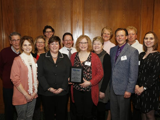 Pink Heals officers and board of directors pose with their award for Non-Profit Organization of the Year Wednesday, Feb. 7, in Mishicot.