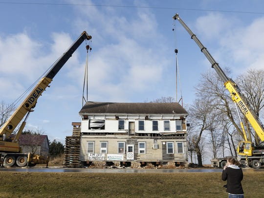 Disassembly begins of the Meeme House Inn, an old stagecoach inn from the late 1800s, Tuesday, Feb. 21, in Newton. The inn will be moved to the Pinecrest Historical Village.