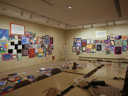 Art made by Manitowoc County students is hung and displayed